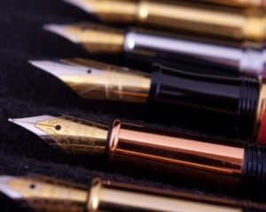 Fountain Pens in a row on a black cloth Dreamstime